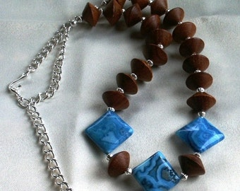 Adjustable Necklace in Blue Crazy Lace Agate with Wood Saucers and Silver Plate