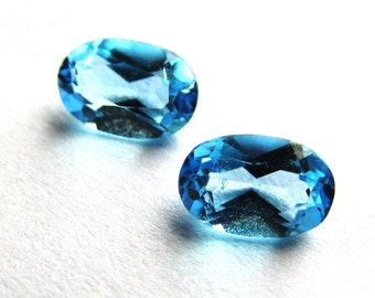 Matched Pair of Swiss Blue Topaz Ovals Over 1.0 ctw 6x4mm Loose Gemstones