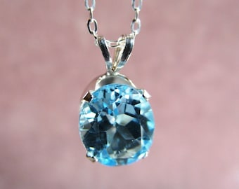 10x8mm Sky Blue Topaz Gemstone Pendant in Sterling Silver with Chain
