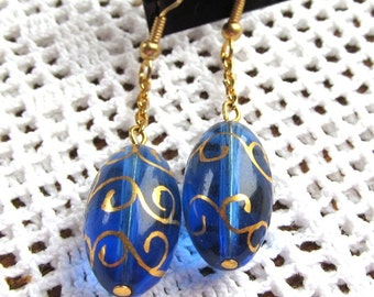 Blue Foiled Glass Oval Beads on Gold-plated Dangle Earrings