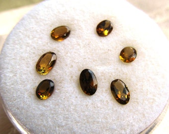 Parcel of Seven Olive Tourmalines 1.45 ctw Mixed Size Loose Gemstones