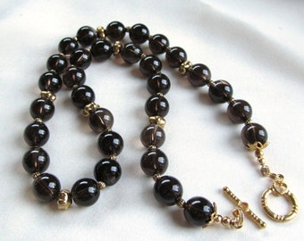 18 inch Necklace of Smoky Quartz 10mm Rounds and Gold Plated Spacer Beads