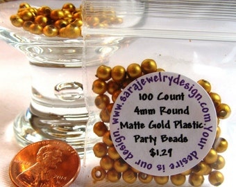 Packet of 100 4mm Matte Gold Plastic Party Beads
