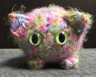 Crocheted pastel rainbow plush kitty