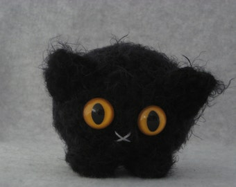 Crocheted black plush kitty