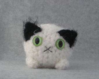 Black and white plush kitty