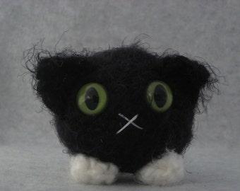 Crocheted black and white tuxedo plush kitty