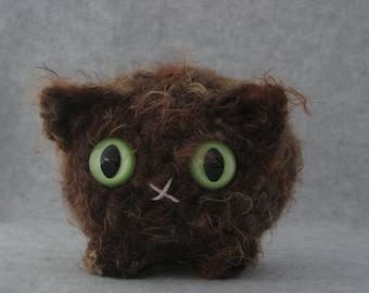Crocheted brown plush kitty