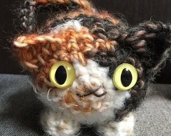Custom crocheted plush kitty portrait