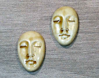 Pair of Two Medium Almond Ceramic Face Stone Cabochons in Peachy Tan