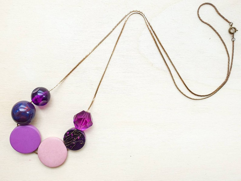 Long chunky asymmetric beaded necklace in shades of purple image 0