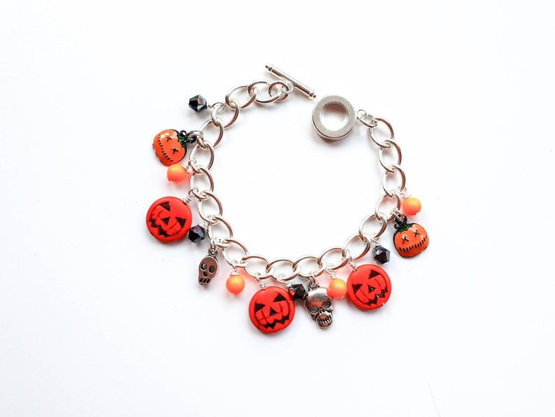 Halloween charm bracelet with pumpkins and skull charms image 0