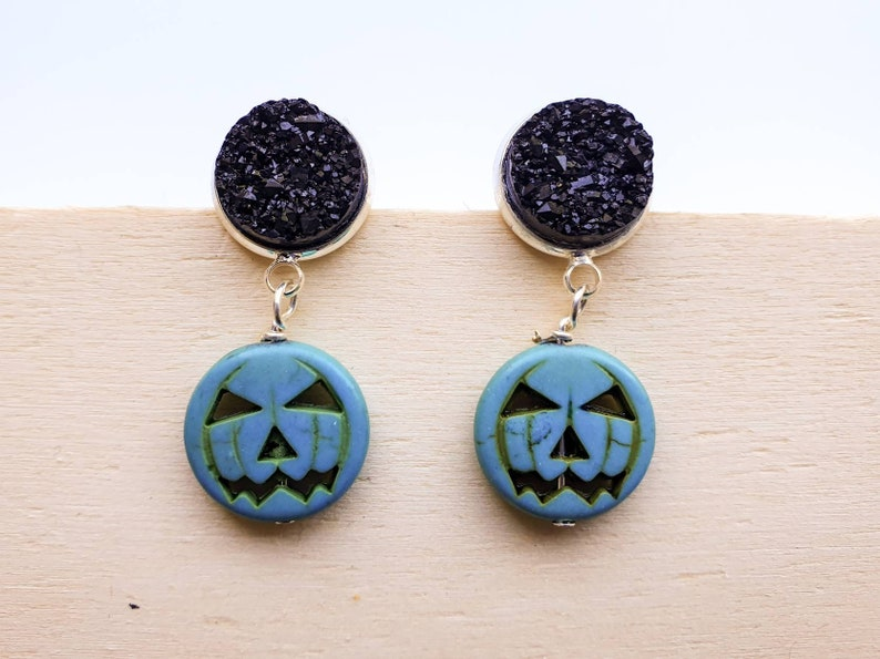 Pumpkin Halloween Jack O Lantern earrings in turquoise blue image 0