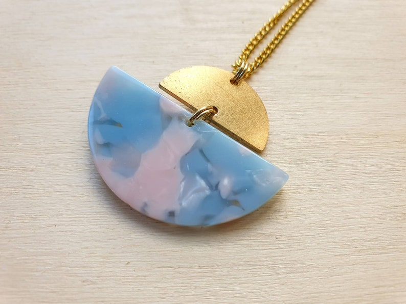 Geometric brass asymmetric semicircle necklace in light blue image 0