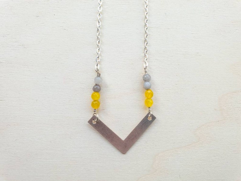 Geometric silver brass chevron necklace with grey and yellow image 0