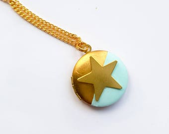 Brass star locket with light blue detail