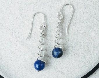 Dark blue (navy) spiral earrings made with sterling silver wire and genuine sodalite gemstone bead