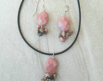 Pink rhodonite with black necklace pendant and earrings set in satin or leather cord.