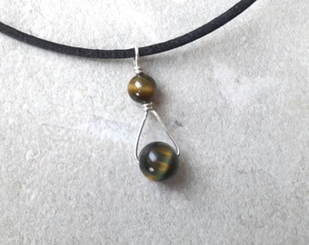 Tiger's eye and sterling silver wire pendant
