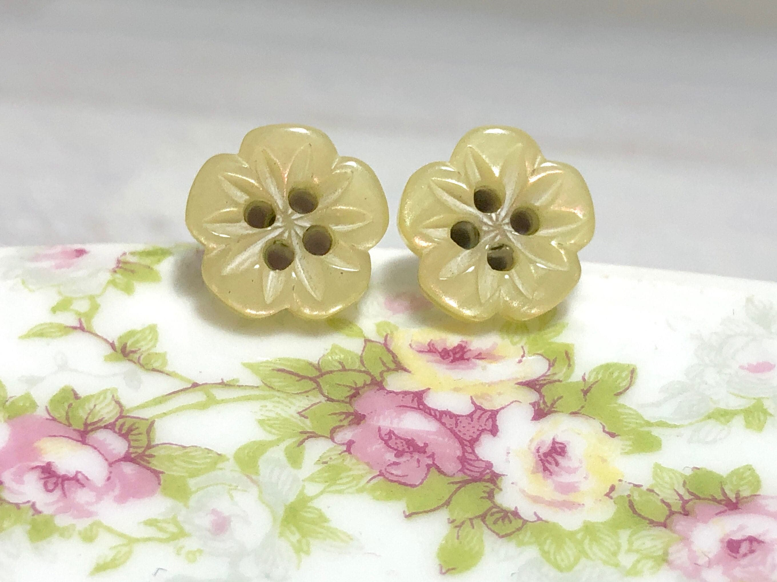 Heavily Carved Iridescent Yellow Five Petal Flower Sewing Button