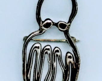 Hey, I'm Lucky and I'm a sterling silver octopus
