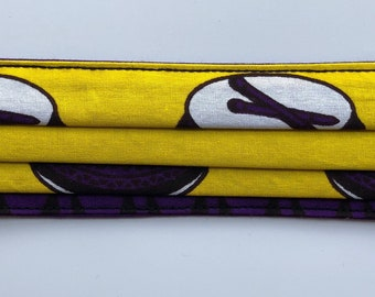 Adults Pleated Face Mask in a Yellow, purple, black and white African wax Print cotton fabric