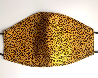 Reusable cotton Adults Face Mask in an orange and black cheetah print