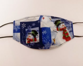 Adults Large Fitted Face Mask in a navy and black Christmas Snow man Print cotton fabric