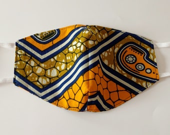 Reusable and Reversible cotton Adults Face Mask in an orange, blue, brown and white African Ankara wax print fabric