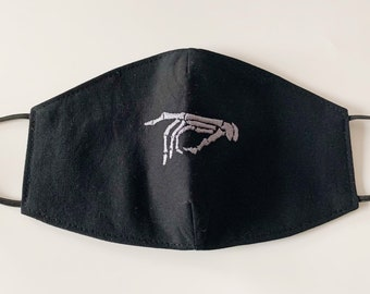 Reusable and Reversible cotton Adults Face Mask in black with grey skeleton pointing finger embroidered on the front