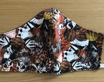 Reversible/Reusable Face Mask in a Brown, black and white animal print with White ear elastics