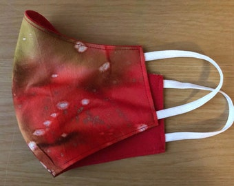 Reversible/Reusable Adult Face Mask in pink, orange and red Batik fabric with ear elastics