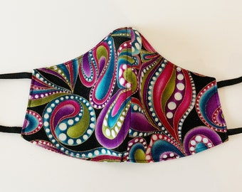 Reversible and Reusable cotton Adults Face Mask in a purple, pink, green, blue and black heart and paisley swirl print