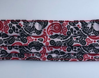 Adults Pleated Face Mask in a White, red and black skull Paisley Print cotton fabric with red lining and ear elastics
