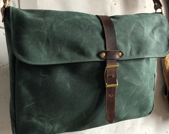 waxed messenger in forest