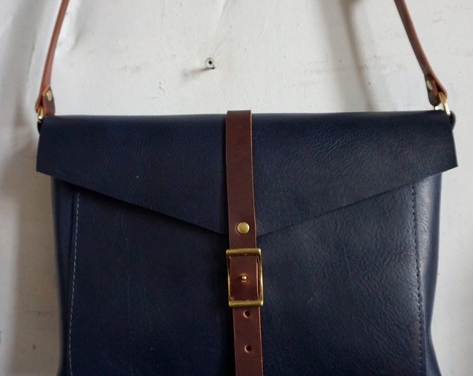 Crossbody reader bag in indigo and cherry
