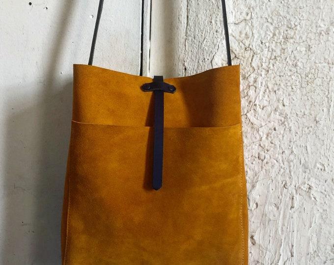 Suede saffron bucket bag