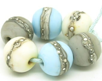Handmade lampwork bead set. Bead pairs. Blue beads. Grey beads. Ivory beads. Etched bead. SRA