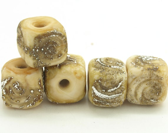 Organic Ivory cubes with spiral textures.