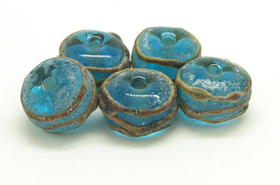 Aged Turquoise and Raku Beads.