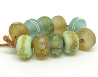 Handmade glass beads. Organic bead set. Frit beads. Green and brown nugget beads. SRA lampwork