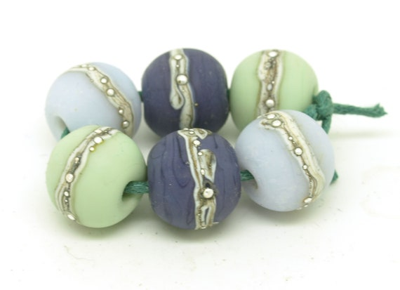 Round bead pairs in shades of purple and pale green