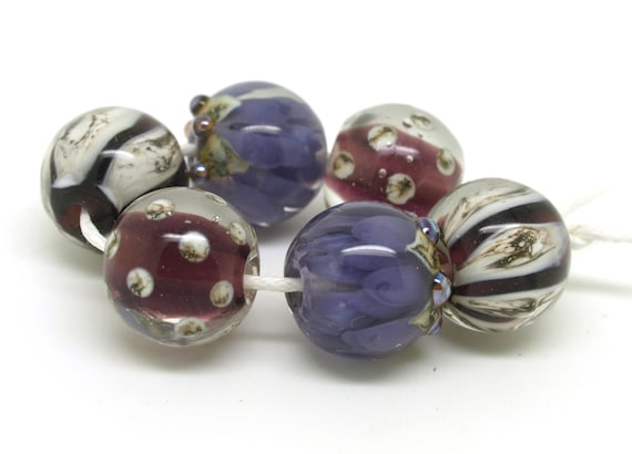 Three Pairs of Beads in Deep Purple and Silvered Ivory.