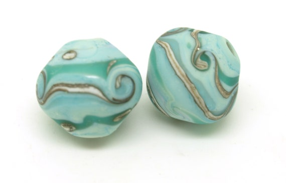 Rounded bicone pair.