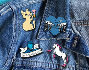 Five Great Enamel Pins from Ugly Baby: Cat Enamel Pin, Star Wars Enamel Pin, Unicorn Enamel Pin, Astronaut Enamel Pin, Feminist Enamel Pin