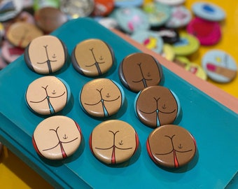 """1.25"""" Button - Butt with Anchor Tattoo (pack of ten)"""