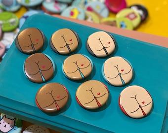 """1.25"""" Button - Butt with Heart Tattoo (pack of ten)"""