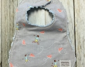 Baby Bib in Paper Airplan...