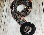Women's Fabric Belt - Metallic Gold and Peach/Grey Floral with a Black Background