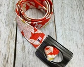 Women's Fabric Belt - Glamorous Flowers in Red with an Orange Background